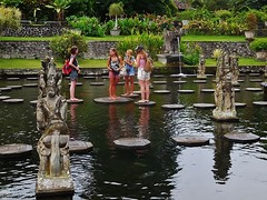 a discussion in the pond (SM Tham) Tags: people bali plants water fountain grass reflections indonesia outdoors island pond asia terraces statues tourists pots watergardens steppingstones walls waterfeature shrubs lawns waterpalace karangasem tirtagangga amlapura gardenstosee
