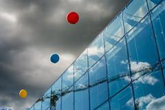 Three Balloons (pni) Tags: blue red sky reflection glass yellow suomi finland helsinki crane balloon helsingfors musichall skrubu pni musikhuset musiikkitalo pekkanikrus
