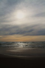 Silver (Stephanie Escobar) Tags: ocean sunset sea sun cold beach nature water weather oregon silver dark landscape grey coast spring pacific emotion earth scenic pacificocean mysterious oregoncoast