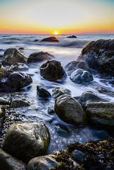 Sunset among the rocks (justinababcock) Tags: ocean sunset sun seaweed beach water island spring nikon rocks long exposure slow rocky shutter d7000