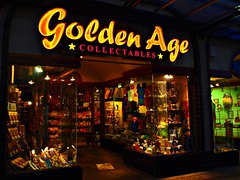 Golden Age (dons projects) Tags: street city decorations canada green window june vancouver gold lights golden store downtown glow bc zoom olympus canadian storefront glowing collectables windowdisplay olympuspen zuiko vancouverbc mft fourthirds 2013 artfilter 1442mm photoscape seeninvancouver goldenagecollectables epl1 microfourthirds 43 popartfilter mzuiko m1442 m1442mm olympuspenepl1 donsprojects