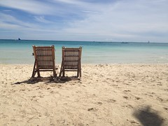 Chairs on White Beach Boracay (ToGa Wanderings) Tags: sea vacation two white holiday beach water beautiful relax coast sand asia warm heaven paradise chairs getaway turquoise empty seat pair philippines lounge shore tropical boracay relaxation uploaded:by=flickrmobile flickriosapp:filter=nofilter