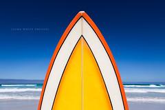 Surf (john white photos) Tags: ocean sea orange abstract yellow coast surf board culture australia bluesky retro coastal surfboard 1970 1980 southaustralia eyrepeninsula