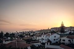 Rooftop Sundown (Adam Haranghy) Tags: street trip travel people holiday cars port puerto photography spain warm harbour urlaub journey finepix shops fujifilm expensive tones andalusien scenes luxury luxus malaga spanien reise x100