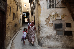 Street scene in Fes (Morocco) (Josep Castell) Tags: world africa street old city travel viaje light shadow people woman black color colour eye blanco luz face architecture corner canon children photography eos photo casa calle mujer arquitectura eyes focus village child gente outdoor mark muslim islam culture photojournalism lifestyle ciudad social amarillo morocco arab ii fez panoramica souk quarter 5d marruecos viejo mujeres mundo souq dignity cultura fes periodico fotografa musulman fotoperiodismo arabes puntual