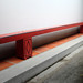 Hong San See red bench along courtyard or skywell