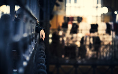 Hanging loose (One_Penny) Tags: city windows light urban man detail canon fence shopping photography town focus hungary colours dof arm market bokeh budapest depthoffield hanging cinematic tones ungarn loose 6d markethall 135f2 centralmarkethall cinematicgrading