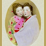 AN OLD PORTRAIT OF TWO JAPANESE WOMEN in CLOSE EMBRACE thumbnail