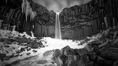 The Black Waterfall-X3.jpg (bayborahan) Tags: longexposure travel winter sky blackandwhite bw cliff snow black slr ice nature water monochrome rock clouds digital photoshop river landscape volcano lava photo waterfall iceland nationalpark nikon rocks europe european day cloudy fineart columns smooth canyon east arctic photograph le processing gorge daytime nordic dslr foss volcanic icicles ísland basalt d800 icelandic glacial skaftafell postprocessing vatnajökull svartifoss travelphotography skaftafellnationalpark southiceland öræfi blackfalls blackwaterfall blackfall thefella öræfasveit 10nd conormacneill vatnajökullnationalpark lavacolumns thefellaphotography