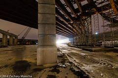 35-E Bridge Construction (EastwoodAudio) Tags: railroad bridge winter orange snow minnesota night train frozen scaffolding cement tracks saintpaul icepuddle afterdark purplesky truss intersectinglines 124am boomcrawlercrane wheresomefeartotread