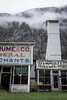 Three Valley Gap (flippers) Tags: ca old cloud mountain canada tower heritage sign shop fog clouds vintage store haze cowboy bc britishcolumbia retro ghosttown merchants watchmaker lowlying threevalleygap 3valleygap columbiashuswape
