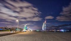 jumeirah beach blue hour (azahar photography) Tags: blue sunset sea cloud motion beach clouds landscape sand dubai waves surfer uae wave emirates burjalarab bluehour jumeirah whiteclouds jumeirahbeach beautifulcolor azaharphotography