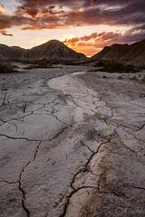 Barren (onelapse) Tags: travel light sunset sun flow midwest nebraska stream warm glow desert dry dirt dreamy cracks drylands