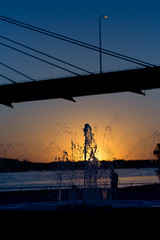 Sunset over the Mississippi... (Angela.Dee) Tags: water river mississippiriver sunset fountain silhouette bridge blue sky canon 6d 100mml 100mm macro cy365 orange clatadamspark quincyil illinois