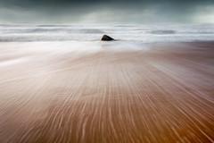 Le rocher (MathieuL33) Tags: ocean sea mer seascape beach rock sand sable wave vague plage rocher mouvement