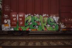 WEEKS (TheGraffitiHunters) Tags: street orange white black green art train graffiti colorful paint gray tracks spray week boxcar weeks freight benched benching