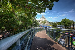 Adventure is Out There (KC Mike D.) Tags: california park mountain tree amusement finding nemo post path disneyland walkway matterhorn framing railing tomorrowland submarines attraction fantasyland autotopia
