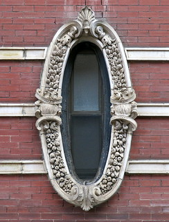 Oval window (1910) facing Waverly Place, 24 Charles Street, Greenwich Village, New York