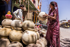 Indian woman buying traditional water pot (marcusfornell) Tags: blue people woman india water clothing women colorful asia asien market traditional clothes clay pottery local colourful tradition sari indien rajasthan streetmarket jodhpur saris southasia bluecity rajasthani sdasien