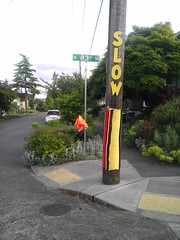Traffic calming utility pole sweater wrap (justsmartdesign) Tags: road seattle street speed diy sweater crossing power slow traffic telephone calming knit greenwood wrap utility safety pole yarn arterial greenways imag0846