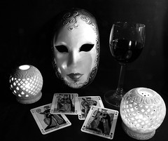 Still Life with mask (thegreensea) Tags: life bw white playing black slr glass contrast cards high still candles russell mask wine olympus peter venetian e410