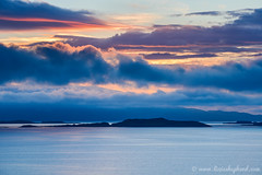 Crinan sunset (LizzieShepherd) Tags: sunset sea clouds islands scotland dusk argyll jura crinan