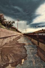 Bike Trail at I-40 and Rio Grande (Paul Anglada) Tags: new storm rain bike clouds mexico shower sand albuquerque stormy erosion trail hdr rainclouds