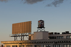 Colorful Water Tower (Joseph Austin) Tags: city newyorkcity roof sunset urban usa newyork color rooftop glass sign brooklyn buildings advertising colorful afternoon watertower dumbo billboard warmlight softlight settingsun blanksign