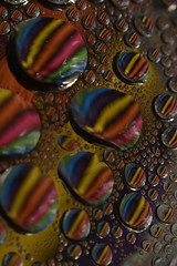 lotsa stripey drops (joy's girl) Tags: macro reflection water waterdrop refraction waterart