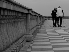 a life together (M@x Ph) Tags: two walking insieme livorno along due scacchi terrazza camminare assieme