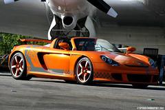 Techart Carrera GT Photoshoot (Spyder Dobro) Tags: orange airport pipes porsche tuner straight rims supercar hanger exotics carreragt tuned techart hypercar techartcarreragt