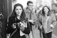 The Pretty One Handed Shooter (Just Ard) Tags: street camera uk england urban bw woman white black girl monochrome canon photography prime mono nikon pretty photographer candid streetphotography 85mm oxford nikkor unposed onehanded primelens d7000 justard justardcom