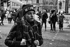 """IMG_0664-Edit - """"Weirdo"""" hat on a beautiful girl (roger_thelwell) Tags: life street city uk winter portrait england people urban bw white black streets cold london lamp monochrome westminster beauty hat rain leather mobile umbrella hair bag walking real photography mono chat shiny phone traffic post natural photos britain circus cigarette candid cab taxi great over sac hats cell photographic smoking lamppost photographs oxford conversation shiney talking shoulder handbag stud speak speaking studs commuters scak weirdohatonabeautifulgirl"""