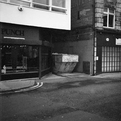 (Delay Tactics) Tags: street bw white black dumpster square opposite shops punch skip doncaster