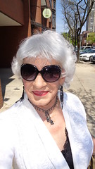 A Beautiful Day To Spend Sauntering Through The Streets Of Milwaukee (Laurette Victoria) Tags: woman sunglasses silver necklace milwaukee earrings laurette