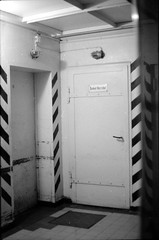 Dunkel-Korridor / dark hallway (n0core) Tags: door bw industry film analog 35mm dark lomography eingang corridor entrance hallway ddr pentacon expired filmmuseum industrie praktica tr gdr korridor dunkel qrs wolfen kombinat urbex historisch orwo veb ostblock mtl5 np22 np27 orwochrom np20 orwopan np15 ut21 filmfabrik filmfilmforever qrs100 ostfilm