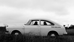 Girls In Cars (lucycawood) Tags: girls shadow bw cars film silhouette landscape friendship flagged