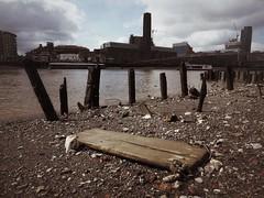 London Has Fallen 2 (Feldore) Tags: old england london english beach thames skyline river pier dock globe decay shingle olympus wharf posts mchugh decaying piles em1 mudlark 1240mm mudlarking feldore