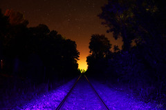 Higway to hell (Mallory Walle) Tags: longexposure blue trees light red portrait man nature up night standing forest train canon de stars rouge stand back long exposure lumière tracks railway led bleu arbres dos pollution rails leafs nuit foret chemin feuilles homme fer étoiles albi bleue etoiles standup cailloux polute debout canoneos550d