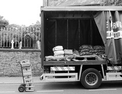 You can't take it with you (David Bergin Photography) Tags: ireland kilkenny nikond3000 streetphotography headstones graveyard street transport food potatoes spaces opened goods delivery parked truck