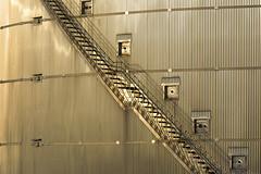 Stairway on a storage tank II (on Explore) (Jan van der Wolf) Tags: light sunset monochrome lines silver licht stairway staircase trap avondlicht storagetank eveninglight monochroom opslagtank playoflines interplayoflines map155196ve