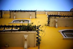 Balcony Spikes. (Juliet everywhere) Tags: travel vacation sky color portugal yellow architecture composition 50mm europe lisbon perspective oldbuildings lookingup traveller balconies travelphotography sonyalpha sonyphotography sonyimages sonynex