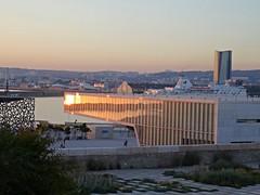 Marseille @ sunset (Hlne_D) Tags: sea mer france museum port harbor boat marseille muse paca aviary provence bateau j1 mediterraneansea vieuxport j4 mditerrane carferry bouchesdurhne mermditerrane provencealpesctedazur diguedularge mucem musedescivilisationsdeleuropeetdelamditerrane tourcmacgm hlned villamditerrane