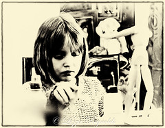 Day 190, 2016, a photo a day. (lizzieisdizzy) Tags: blackandwhite table child daughter young girl arty art work concentration concentrating involved painting gluing making depthoffeild female fairhaired lookingdown woodenmodel glue gum hands busy