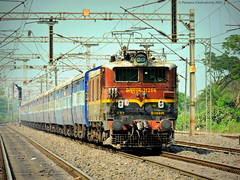 Indian Railways : One of the most unique liveried loco of IR ! VSKP WAM 4 races past with SRC TPJ Express towards Kharagpur ! (Clicker Purnava) Tags: sf road railroad sky india beautiful beauty electric speed train ir amazing track day afternoon cloudy unique indian awesome extreme ngc transport cruising rail overcast loco wb rails locomotive express passenger endangered ser sel incredible railways epic bengal railfan conventional trainspotting src throttle outstanding iri westbengal mps indianrailways superfast natgeo cloudyday railfanning trainspotters indiatravel tpj irfca railfans incredibleindia trainwatchers clw tiruchchirapalli wam4 southeasternrailway ecor indialove santragachi railbuff eastcoastrailway sankrail ferroequinologist worldtrains discoveryindia marvelshots trainsworldwide railwaylovers
