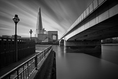 London Bridge (vulture labs) Tags: city uk longexposure bridge light england sky urban bw building london art monochrome lines thames skyline architecture clouds composition skyscraper londonbridge river landscape concrete phot