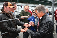 Mario Andretti signs autographs for fans (indianapolismotorspeedway.com) Tags: camera speed canon mark length mode rating eos1d 241 5focal 2810iso iiiexposure 250metering 1400fnumber