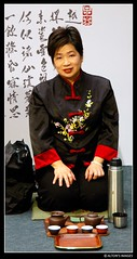 Eve with Tea (alton.tw) Tags: eve red portrait people woman black female writing asian island costume nikon asia tea drink text taiwan service taipei feed tradition formosa 台灣 台北 alton altonthompson taiwanese traditionaldress 2007 twtc 唐博敦 taiwanphotographers altonsimages