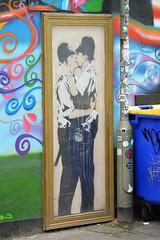 Banksy Kissing Policemen - Worldwide Photo Walk 2013 - Brighton (vic_burton) Tags: street city blue red urban orange house colour building green yellow wall graffiti town kiss kissing uniform brighton paint bright vibrant rich steps banksy spray worldwide photowalk spraypaint spraycan policemen scottkelby worldwidephotowalk