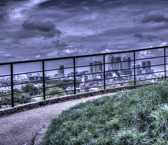 Canary through the wire. (ArtGordon1) Tags: uk england london fence landscape cityscape greenwich canarywharf greenwichpark canadatower viewoflondon davegordon londonview davidgordon londondockland artgordon1 daveartgordon daveagordon davidagordon